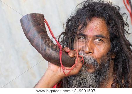 BABUGHAT, KOLKATA, WEST BENGAL / INDIA - 10TH JANUARY 2015 : Portrait of Hindu Sadhu aginst bright background.