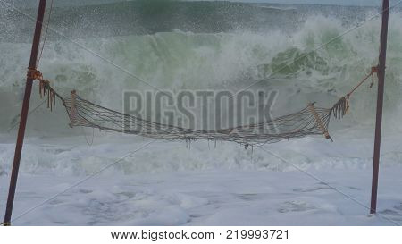hammock on the beach during a storm, big waves.