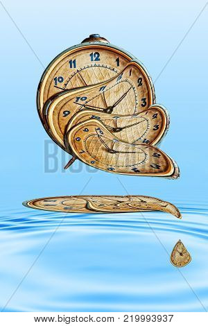 Liquid and flexible time concept.Surreal Alarm clock transforming and thawing in blue water ripples.