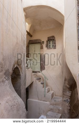 Stairs and door in the old traditional village of Emporio, Santorini, Greece