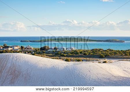 The coastal town of Lancelin and Edwards Islands Nature Reserve visible in the distance. Lancelin, Western Australia, Australia.