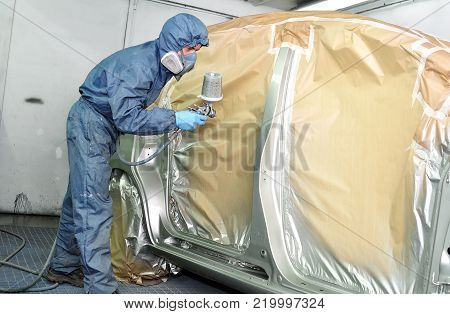 Car painting in a professional body shop.