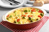 Baking dish with yummy brussel sprouts casserole on table poster