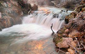 Winter scene with river in Tuhinj valley in Slovenia