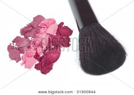 cream eyeshadows with brush isolated on white background