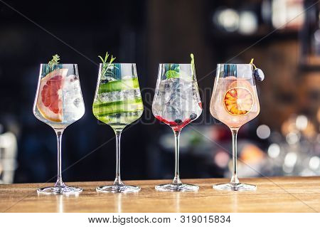 Gin Tonic Cocktails In Wine Glasses On Bar Counter In Pup Or Restaurant.