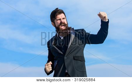 Success And Luck. Being Optimistic. Man Bearded Optimistic Businessman Wear Formal Suit Sky Backgrou