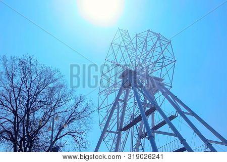 Set Up Of Ferris Wheel In Amusement Park On Sky Background.