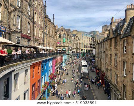 EDINBURGH, UK - AUGUST 24, 2019: Edinburgh Fringe Festival revellers on Victoria Terrace and Victoria Street below in the Old Town of Edinburgh, Scotland, UK.