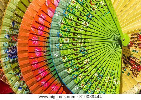 Colorful Traditional Paper Fans At A Souvenir Shop In Sevilla, Spain