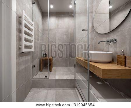 Stylish Modern Bathroom With Light Tiled Walls And Floor
