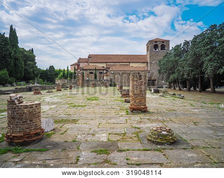 Panoramic View Of San Giusto Cathedral And Roman Forum Ruins In Trieste, Northern Italy