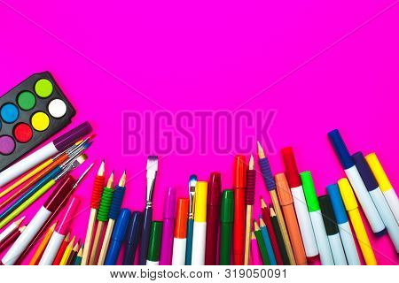 School Supplies On Pink Neon Background And Note Book With Copy Space. Back To School Concept.