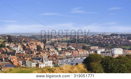 Whitby, North Yorkshire, England - Aug 24, 2019:,uk. Panorama View From A Cliff Down To The Bridge A