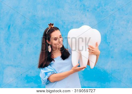 Woman In Tooth Fairy Costume Holding Big Molar