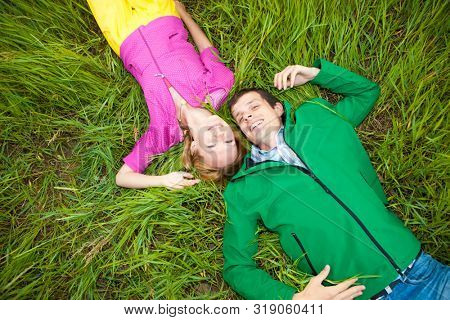couple in love lies on green grass