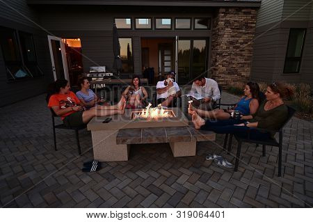Sisters, Oregon - August 14, 2019 - Family And Friends Enjoy Afternoon Around Fire Pit In Sisters, O