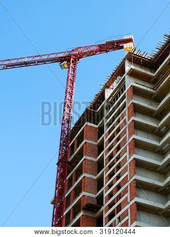 Construction Site. High-rise Multi-storey Building Under Construction. Tower Cranes Near Building.