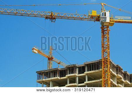 Construction Site. High-rise Multi-storey Buildings Under Construction. Tower Cranes Near Buildings.