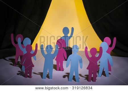Protest And Strike Of People. Paper People Are Standing With Their Hands Up, Next To The Speaker, A