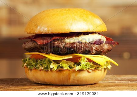 A Hamburger (short: Burger) Is A Sandwich Consisting Of One Or More Cooked Patties Of Ground Meat, U