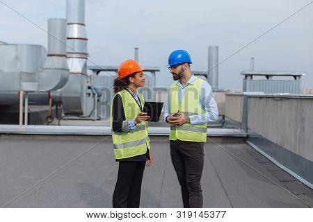 Construction Industry Charismatic African Woman Engineer Using A Tablet To Analyzing The Plan Of Con