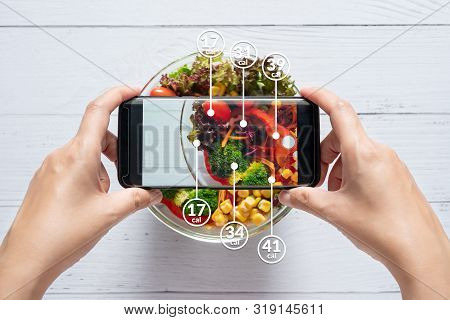 Calories Counting And Food Control Concept. Woman Using Application On Smartphone For Scanning The A