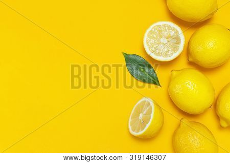 Ripe Juicy Lemons And Green Leaves On Bright Yellow Background. Lemon Fruit, Citrus Minimal Concept,