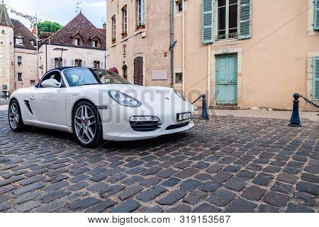 France Beaune 2019-06-19 Image Of White German Car Porsche Boxster Parking On European Street