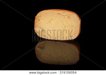 Half Of Hard Porous Yellow Edam Cheese Head With Holes