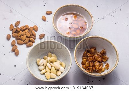 Preparation Of Almond Milk From Soaked And Peeled Nuts. Vegan Milk Alternative Concept