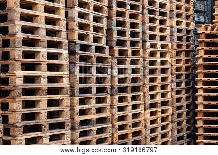 France Beaune 2019-06-20 Closeup Lot Of Wooden Dirty Pallets, Pallets Stacked In A Pile, Pile. Conce