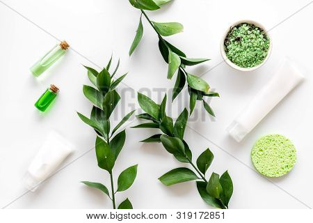 Skin Care With Natural Cosmetics With Herbal Extract On White Background Top View