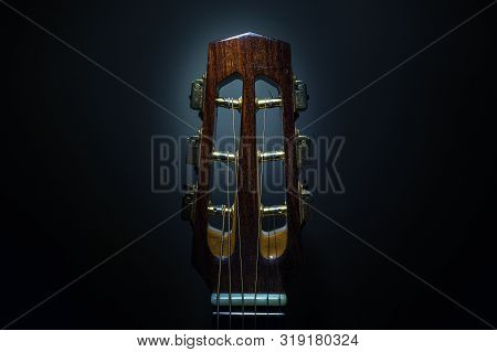 Details Of An Old And Dusty Gypsy Jazz Acoustic Guitar, Django Style, Closeup View Of Head And Tuner