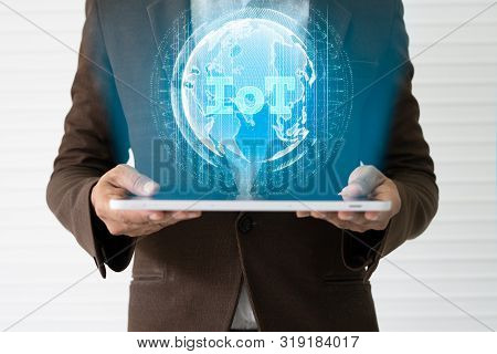 Internet Of Things Concept (iot) And 5g With Male Hands Holding Tablet Or Large Smart Phone In Order