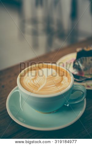 Cup Of Coffee Latte In Coffee Shop.beautiful Foam,ceramic Cups, Place For Text.vintage Tone.