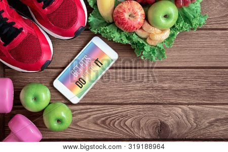 Fitness Healthy Lifestyle Mockup Smartphone Concept. Get Fits Don't Quit Quote On Mobile Phone With