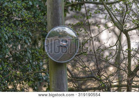 Blind spot convex mirror on a post in Aspley Guise, Milton Keyns poster