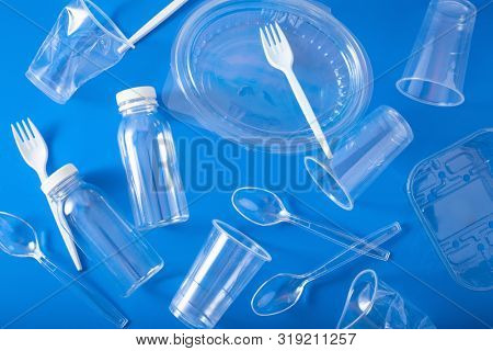 single use plastic bottles, cups, forks, spoons. concept of recycling plastic, plastic waste