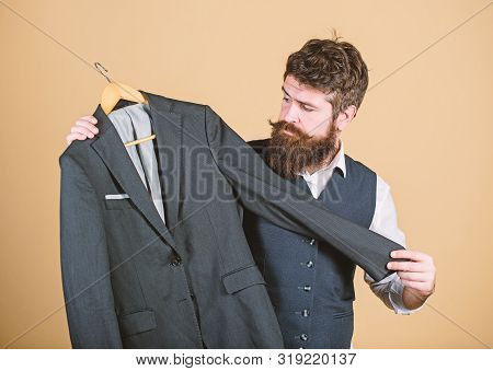 Looking Professional With Business Casual Look. Businessman Choosing Suit Jacket For Casual Dress Co