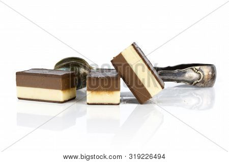 Group of three whole mellow two coloured nougat piece with sugar tongs isolated on white background poster