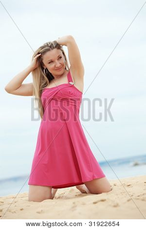 Middle aged woman resting at beach near the sea