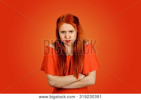 Portrait Of A Beautiful Very Frustrated Enraged Woman, Mouth Full Of Air, Hands Crossed Isolated On