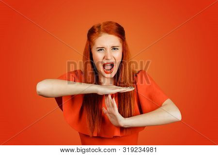 Portrait Of A Beautiful Woman Screaming, Gesturing Time Out With Her Hands Isolated On Red Backgroun