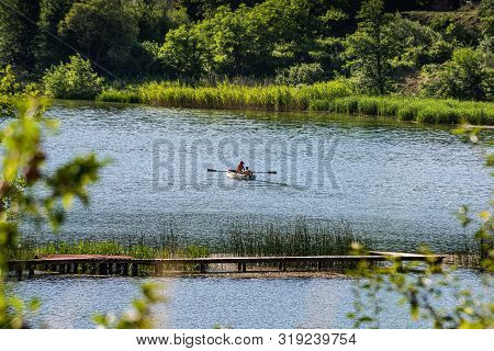 Small Boat On Plivsko Lake - It Is A Part Artificial, Part Natural Lake In Bosnia And Herzegovina, L