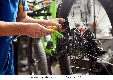 Cropped Shot Of Male Mechanic Making Service In Bicycle Repair Shop, Repairing Modern Bike Brakes Us