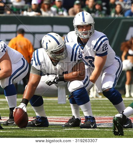 East Rutherford, NJ - OCT 14: Indianapolis Colts quarterback Andrew Luck (12) takes the snap from center Samson Satele (64) against the New York Jets on October 14, 2012 at MetLife Stadium.