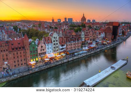 Gdansk, Poland - August 21, 2019: Beautiful sunset over the old town of Gdansk, Poland. Gdansk is the historical capital of Polish Pomerania with beautiful architecture.
