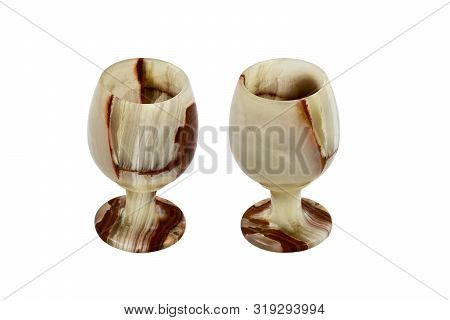Wine Glasses Made Of Stone Onyx Varieties Of Layered Chalcedony, Isolated On White Background.