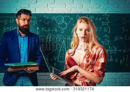 Back To School. Sexy Gorgeous Blonde Woman Near Blackboard With Teacher Man. Sexology Teacher Looks
